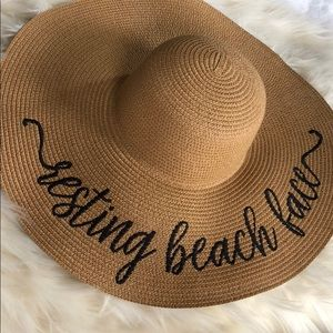 Resting beach face slightly floppy beach hat